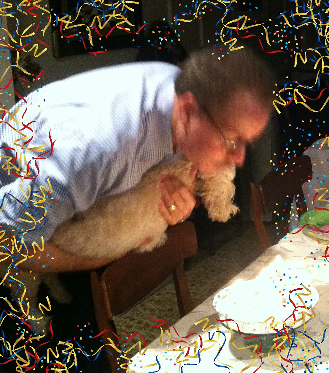 "Uncle Bill and his doggy ""Brewster"" blowing out candles on his birthday cake!"